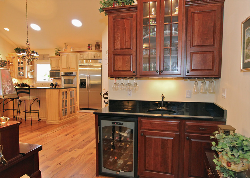 Butler's panty with wine cooler located between dining area and kitchen.