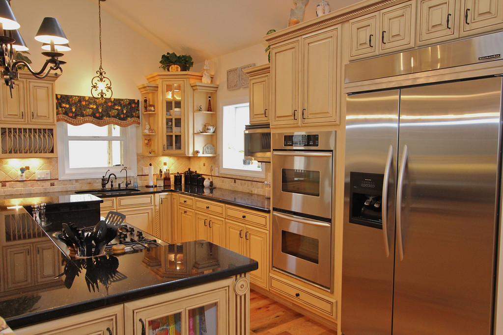 From the downdraft gas cooktop to the double ovens this kitchen is fully prepared for any occasion.