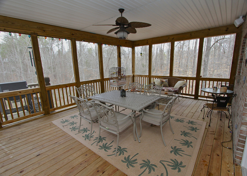 Massive screened porch off the kitchen with great views of back acreage perfect for seasonal entertaining.