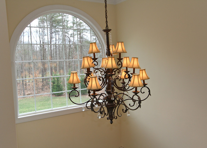 Elegant chandeliers are throughout the home.