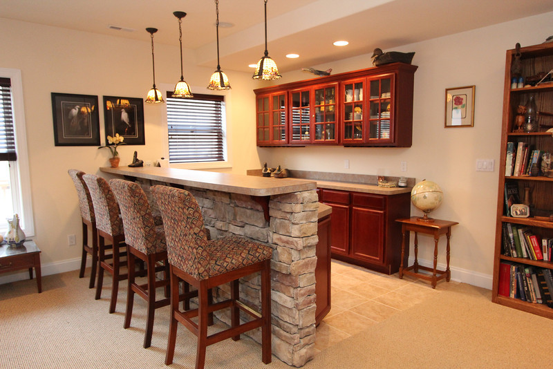 Fantastic wet bar on lower level enjoys great sunlight from rear windows and walk out entrance.