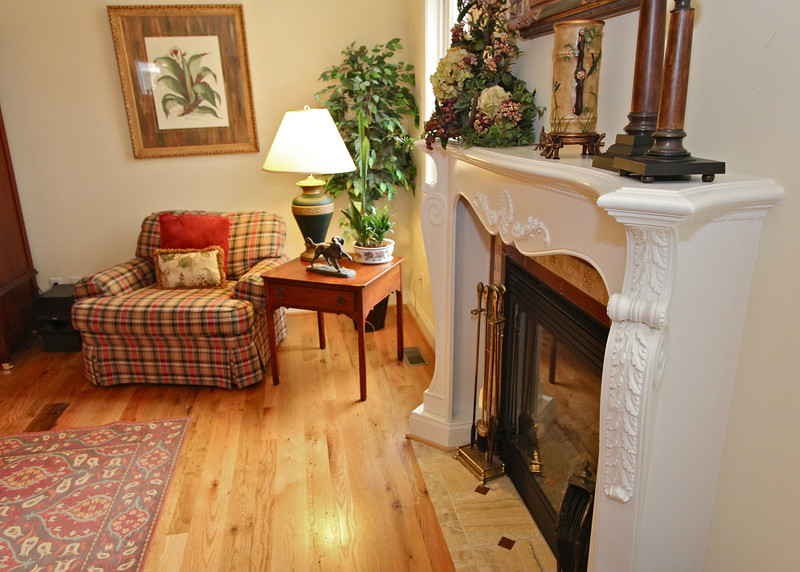 Old world elegance adorns the mantle for the family room's gas fireplace.