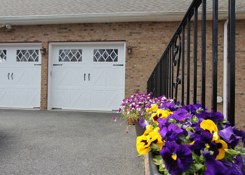 Great touches abound like this wrought iron railing next to the garage side parking area.