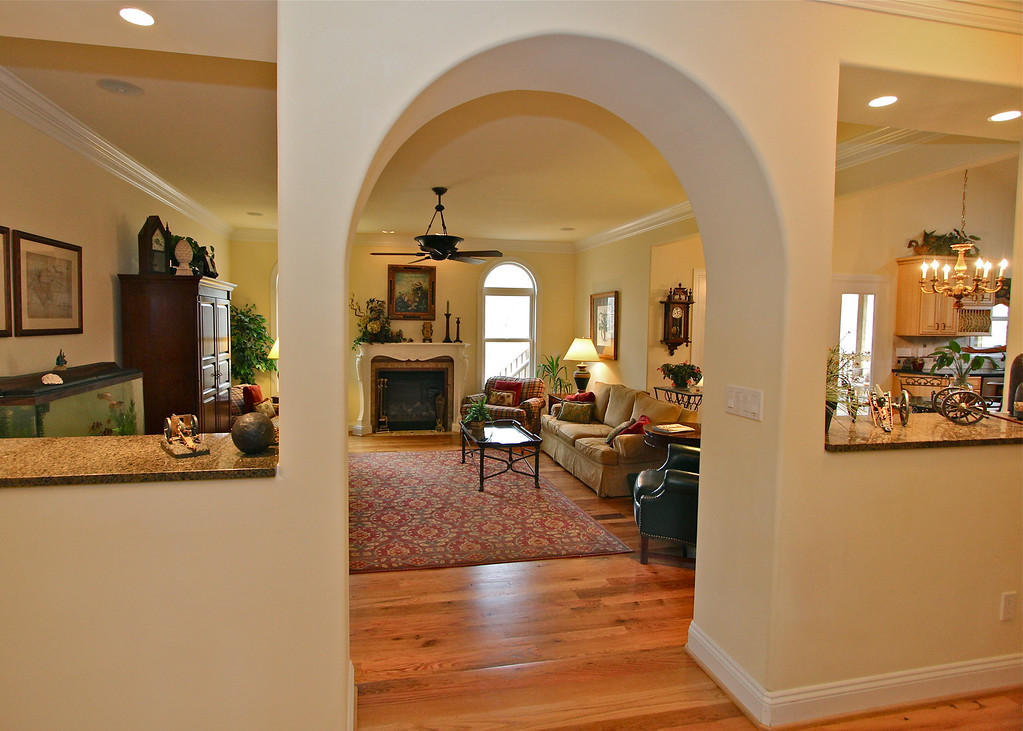 Archway to family room off the kitchen is another example of the many extra touches throughout this fine property.