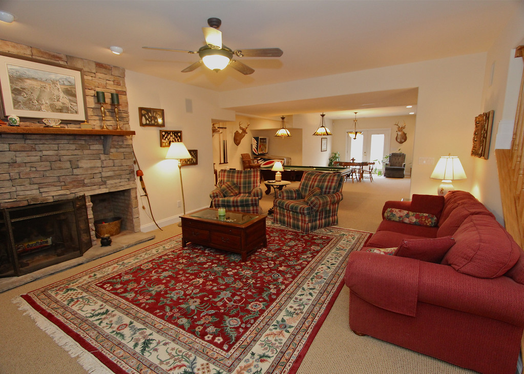 Fully finished lower level is enormous space with a great stone wood-burning fireplace.