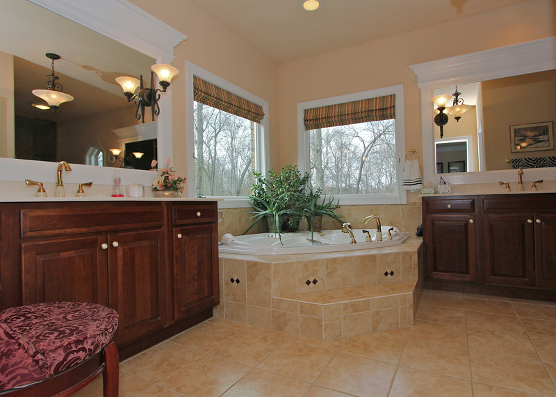 Master Bath is incredible with separate vanities, great view from the jetted tub and amazing walk-in shower.