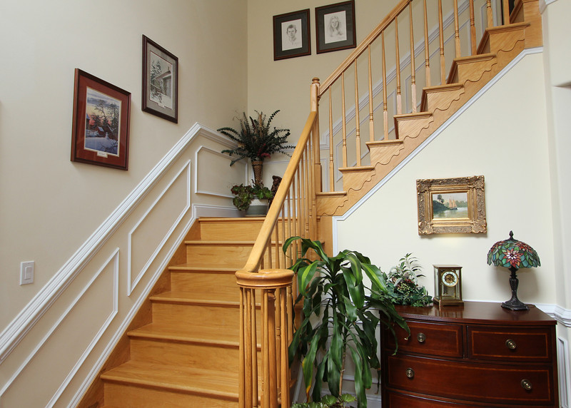 Beautiful staircase winds to upper level.