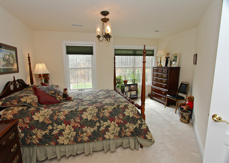 One of the upper level bedrooms.