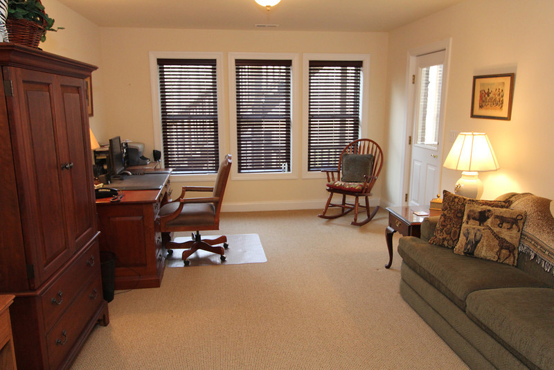 This lower level room can be used for anything from and office to a bedroom and features full windows and separate wall out to the rear of home.