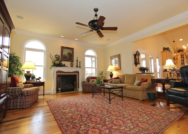 Great family room off the kitchen has a gas fireplace, built-in bookcases and speaker system.