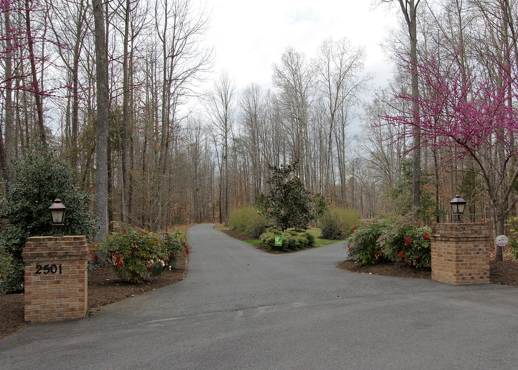 Entrance to the property features a split driveway allowing easy access and egress.