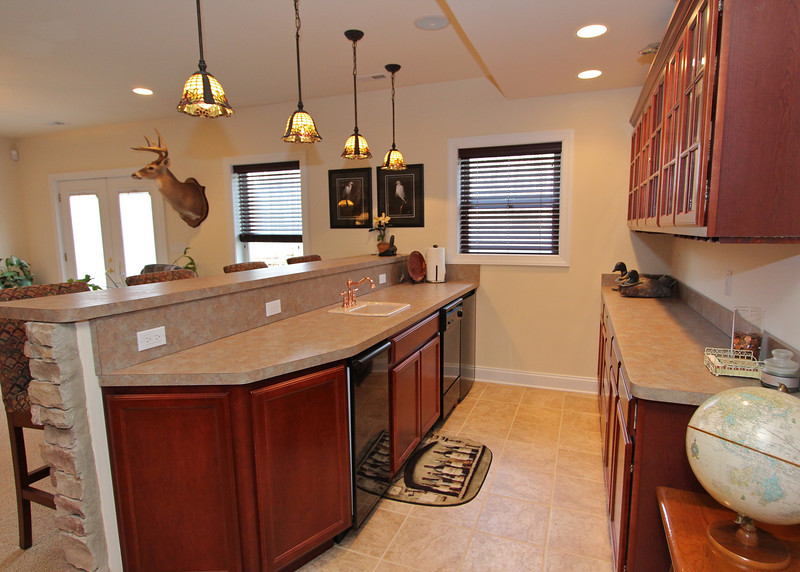 Well designed wet bar features a dishwasher, refrigerator and separate ice-maker!