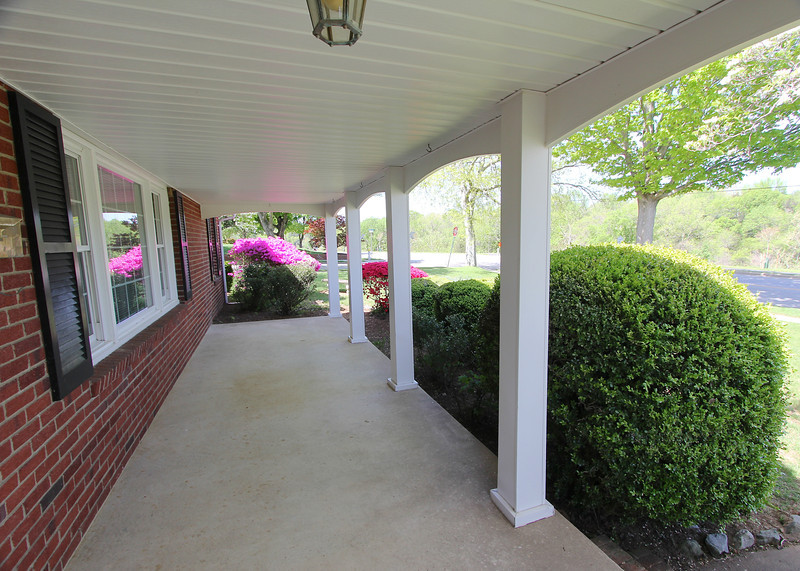 Great covered front porch along Riverside Drive