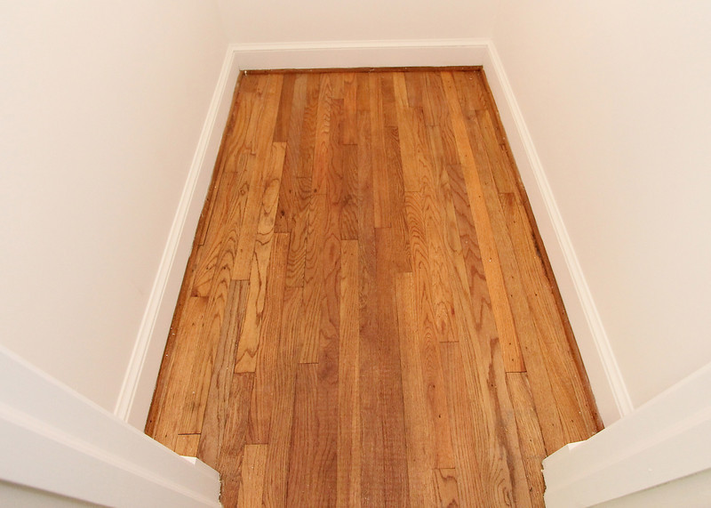 Original hardwood flooring is under the carpet (this is a bedroom closet) that's throughout most rooms.