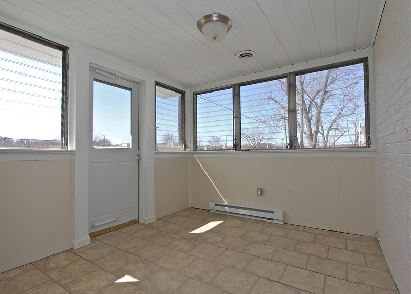 Fantastic glass enclosed porch off the kitchen has a separate outside entrance too!