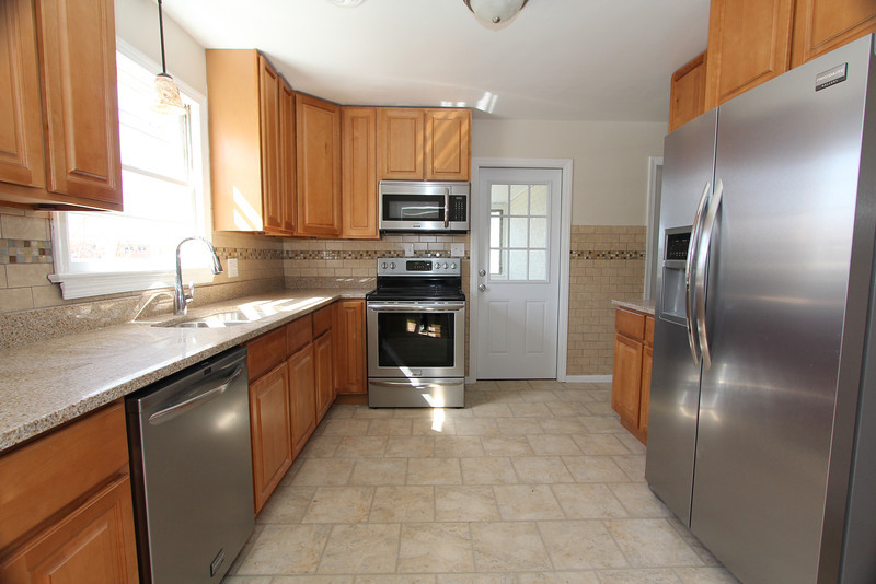 Completely updated kitchen features granite, ceramic and stainless appliances.