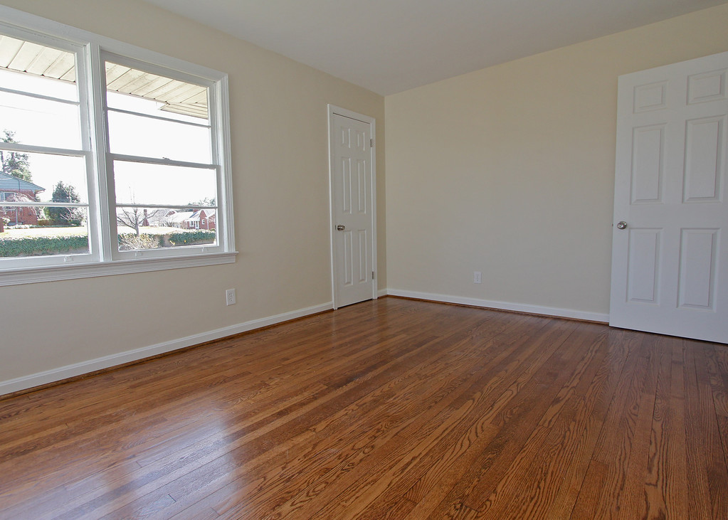 Spacious 2nd bedroom has great windows and two cedar-lined closets!