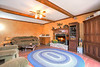 Convenient Wet Bar and Wooden Beams Enhance this Family Room