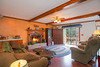 Family Room with Fireplace Opens to Lower Deck