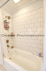 Upstairs Tub with Tile Walls