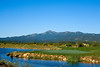 Scenic lakefront green, hole 15, with 12,000-foot Sierra Blanca in the distance, Rainmakers Golf & Recreation Community, Alto, New Mexico (Ruidoso)