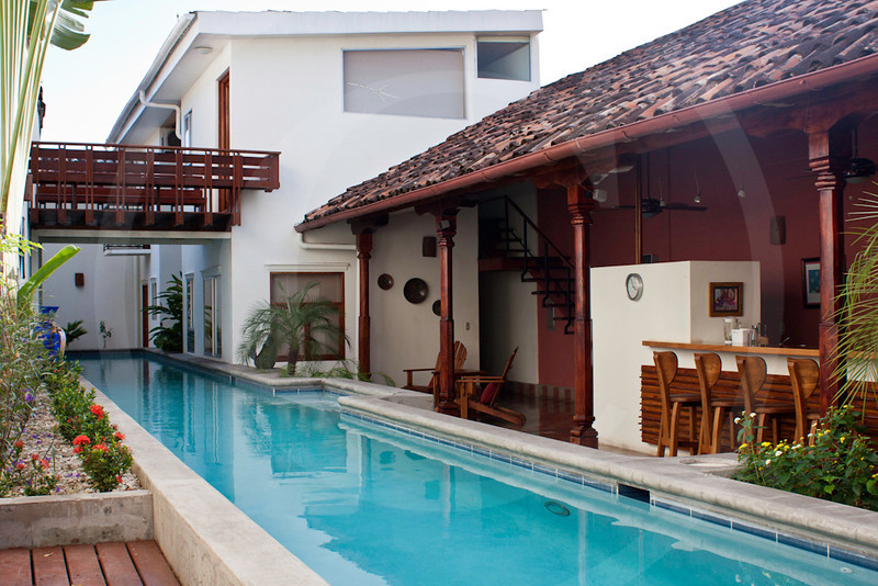 Pool and kitchen area with view to second level, Casa Yalula, Granada, Nicaragua.