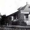 Early photo of the house.  Eventually, the front dormer (north side) was expanded, the porch was enclosed and a series of pocket windows were installed on the east side (left of photo).  All of this work was done in the 30's by Mr. Hobbs.