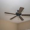 ceiling fan in downstairs bedroom is taken apart-  globe is in closet