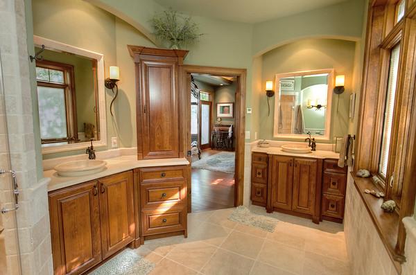 Master bath boasting plenty of storage and his/her sinks