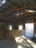 Another view of wood stalls. Secure tack/feed room is to the right of the pipe gate.