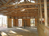 Barn interior. 2 Priefert panel stalls (straight ahead) and 2 wood stalls (right).