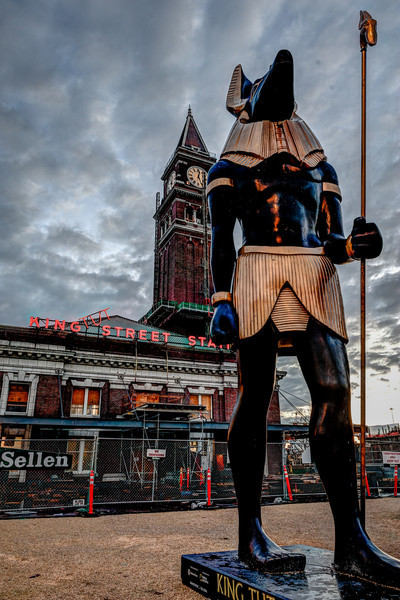 Anubis at King Tut Street Station<br /> Anubis, the god of Egyptian afterlife, stands outside the King Street Station.<br /> The 28-foot tall, half-ton statue was erected for the King Tut exhibit at the Pacific Science Center.