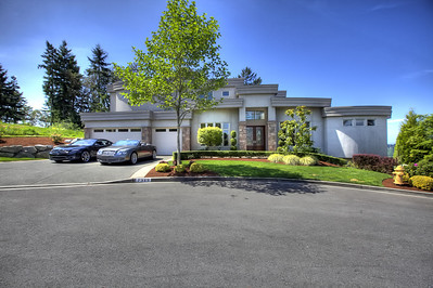 Thach Nguyen - Real Estate Specialist  Phone: 206-334-8773 Fax: 206-322-3022  $1,150,000 7329  117TH PLACE SE  Newcastle, WA 98056 Bedroom: 4 | Bathroom: 4.75 MLS# 357752 www.johnlscott.com/32724 Elegant Custom Built Home with Beautiful Lake Washington Views! Gourmet Kitchen w/Granite Slab Counter Tops & Commercial Grade Appliances. High end finishes and built-ins throughout. Complete w/Separate Living Room, Formal Dining room & Den. Private Master Suite with double shower and jetted tub. Huge Family Room with Granite Gas Fireplace. View Decks From Each Level, Media Rm w/Two entrances. 2 furnaces with dual zones for comfort and 2 A/C's, 2 hot water tanks, vacuum system. 3 Car Garage