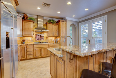 Custom Kitchen, Granite Countertops, Gas Range, Island Sink, Upgraded appliances, 10' ceilings, opens to greatroom, French Doors open to atrium!