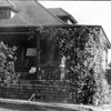 Front of house, before the dormer was expanded and before the porch was enclosed.
