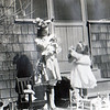 Betty and Katty playing with dolls at the south end of the house where my present office is.  This is before the windows were added.  The faucet is still in the same place