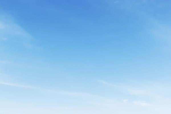 Fantastic soft white clouds against blue sky background, soft focus.