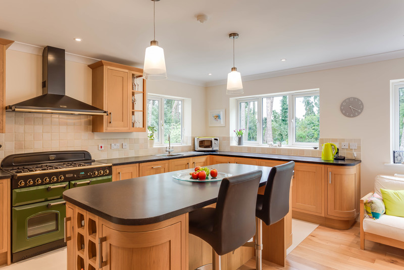 Welcoming kitchen with large island and range cooker