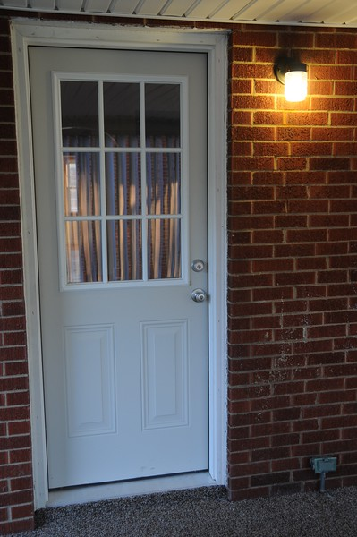 """""""New Energy Efficient Kitchen Door"""". Images from 177 Hopwood Fairchance Rd.  Newly renovated well built home for sale. Large lot, brick siding, 2 bedroom, 2 full bathrooms, tile everywhere, hardwood floors, carpet, full finished basement, garage, attention to detail, great neighborhood, Laurel Highlands School District."""