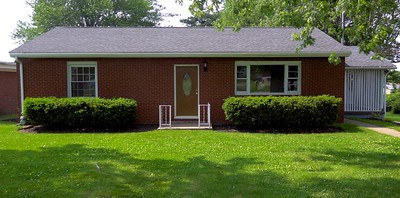 """Front View"". Newly renovated well built home for sale. Large lot, brick siding, 2 bedroom, 2 full bathrooms, tile everywhere, hardwood floors, carpet, full finished basement, garage, attention to detail, great neighborhood, Laurel Highlands School District. New roof with dimensional shingles, landscaping and outdoor carpet, along with a new energy efficient door."