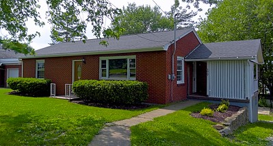 """Front View"". Newly renovated well built home for sale. Large lot, brick siding, 2 bedroom, 2 full bathrooms, tile everywhere, hardwood floors, carpet, full finished basement, garage, attention to detail, great neighborhood, Laurel Highlands School District. New gutters, electrical service and landscaping along with recently planted bushes."
