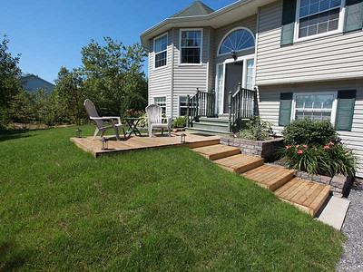 A tastefully modest front deck compliments the front lawn and adds to the charm of this property.