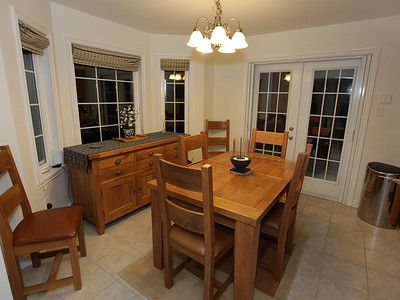 Dining area with french doors leading on to the large deck.