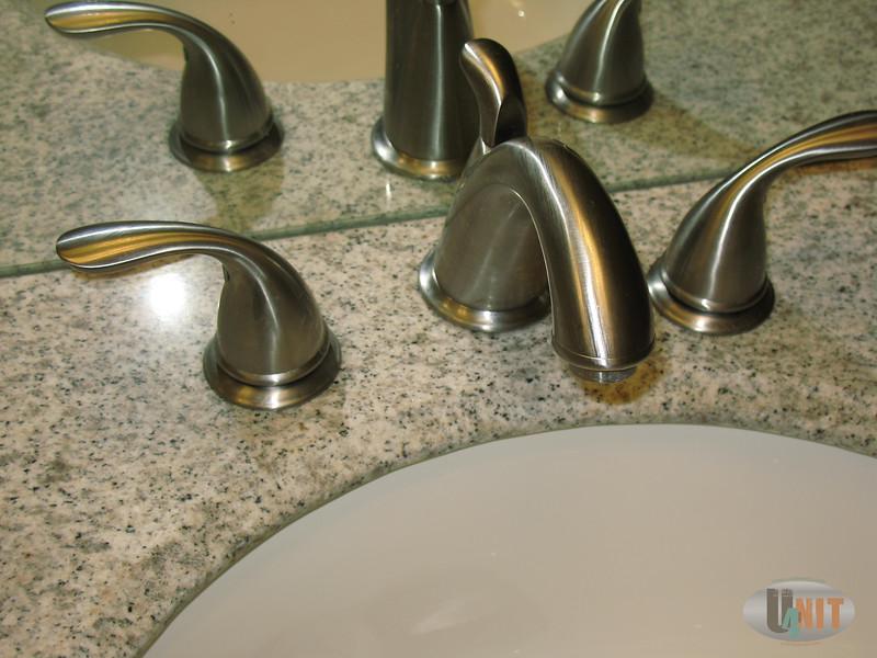 Upstairs bathroom, marble sink faucet detail