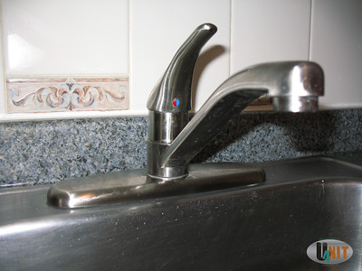 Brushed nickel kitchen faucet detail.