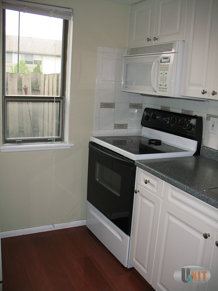 Kitchen all modern well functioning appliances, brushed nickel hardware and faucet.  Mahogany wood flooring