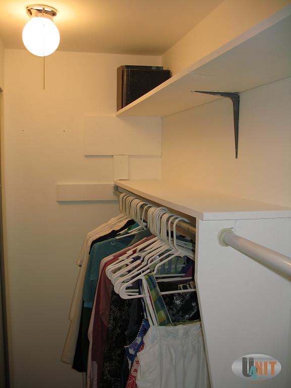 Substantial lit closet in bedroom.