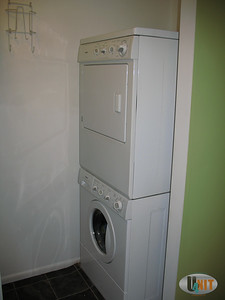 Built-in stand up washer dryer unit in second bedroom closet