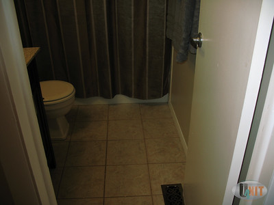 Tile flooring throughout bathroom.