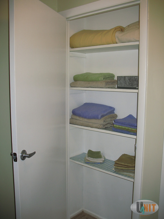 Linen closet detail. All upstairs doors have brushed nickel door handles.